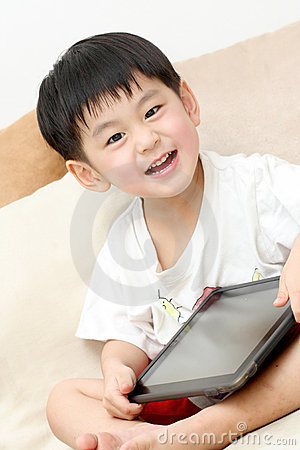 Happy Asian boy with Ipad
