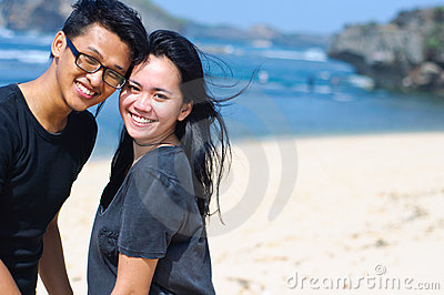 Happy asian couple on the beach