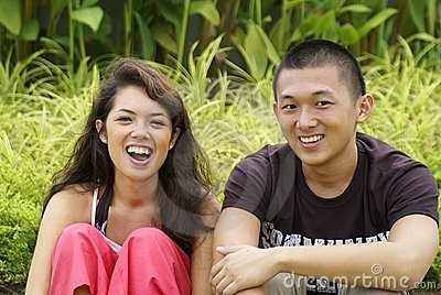Happy asian couple laughing