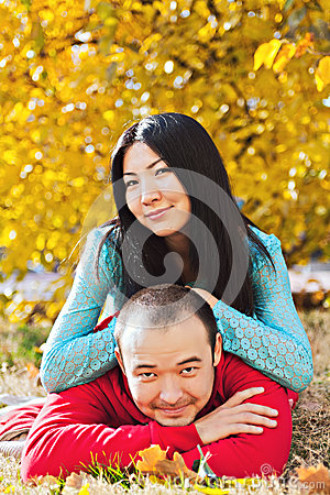 Happy asian couple in love in autumn