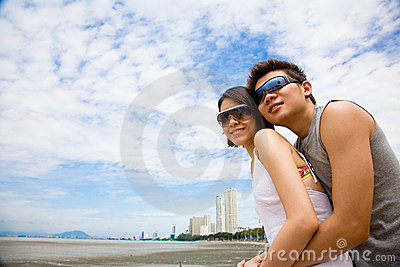 Happy asian couples enjoying the sea view