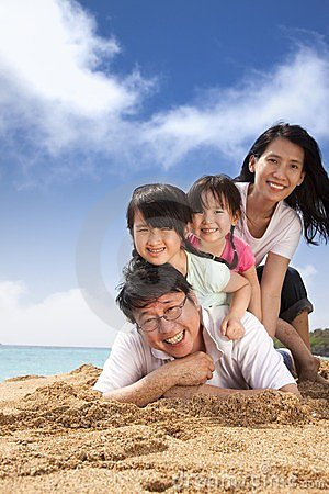 Happy asian family on the beach