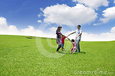 Happy Asian Family on Field