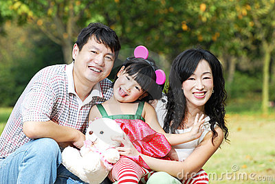 Happy asian family outdoors