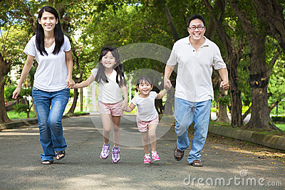 Happy asian family riding bicycle