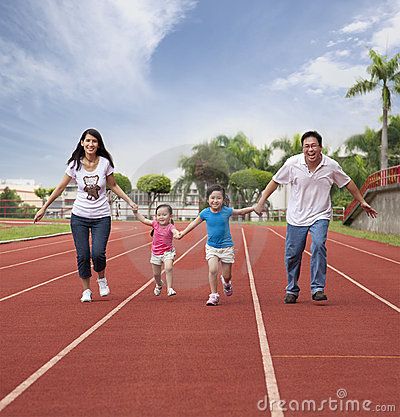 Happy asian family running together