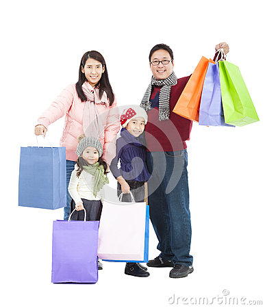 Happy asian family with shopping bag