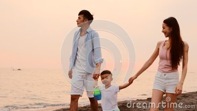 Happy asian family walking on beach stock video footage