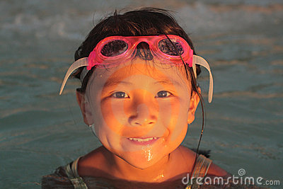 Happy Asian Girl on Beach