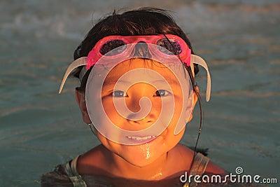 Happy Asian Girl on Beach