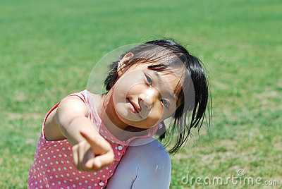 Happy  Asian little girl on grass