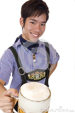 Happy Asian man holds Oktoberfest beer stein
