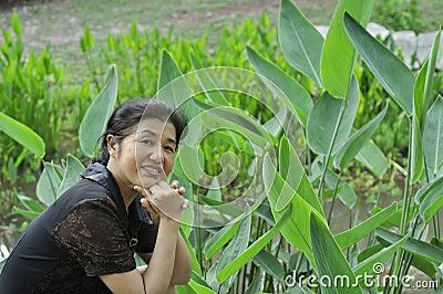 Happy asian mature woman