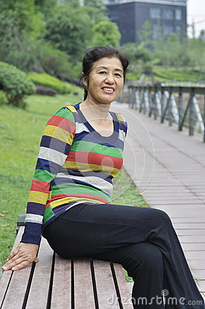 Happy asian mature woman