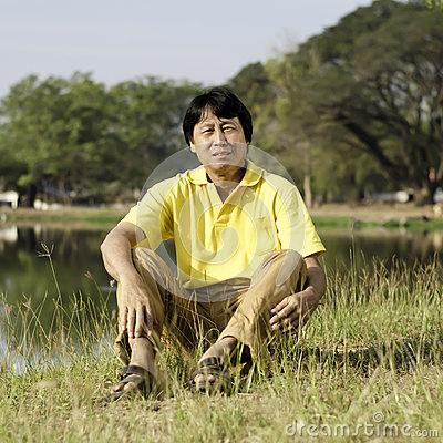 Asian middle-aged man in the park