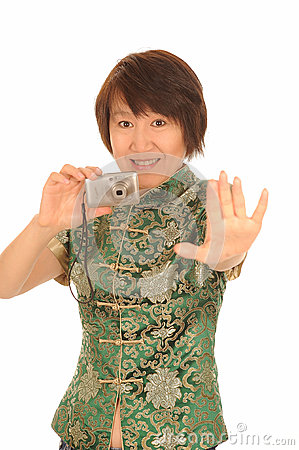 Happy Asian woman with camera