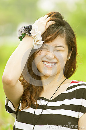 Happy asian woman in countryside