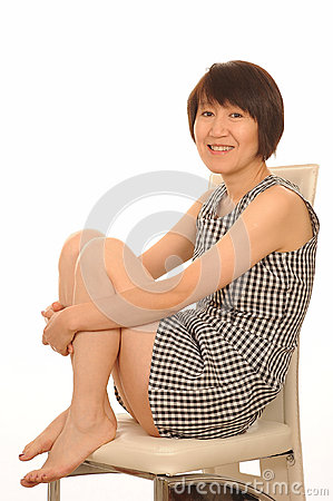Happy Asian woman in dress