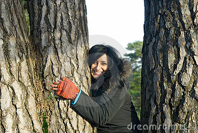 Happy Asian woman hugging a tree