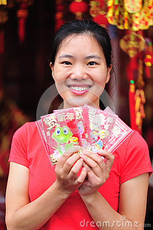 Happy asian woman with red packs
