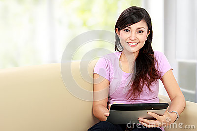 Happy asian woman using tablet pc