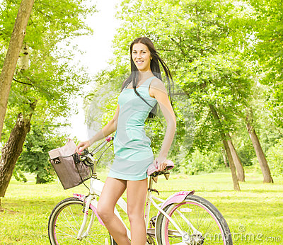 Happy attractive girl with bicycle