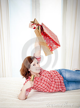 Happy attractive woman online shopping