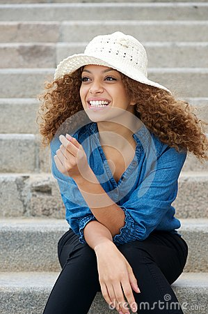 Happy and attractive young woman laughing outdoors