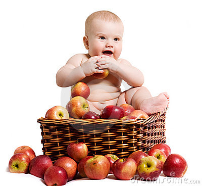 Happy baby in the basket with apples
