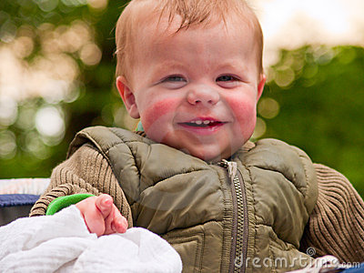 Happy baby boy laughing with joy