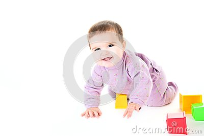 Happy baby with bricks