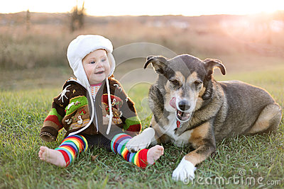 Happy baby bundled up outside in winter with pet dog stock photo image 63964595 - Keeping outdoor dog happy winter ...
