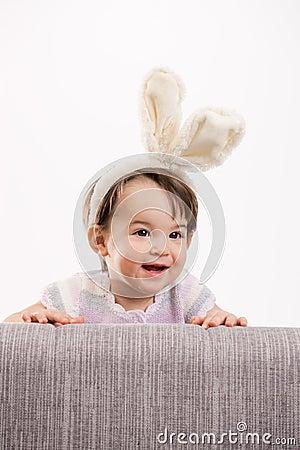Happy baby girl in easter costume