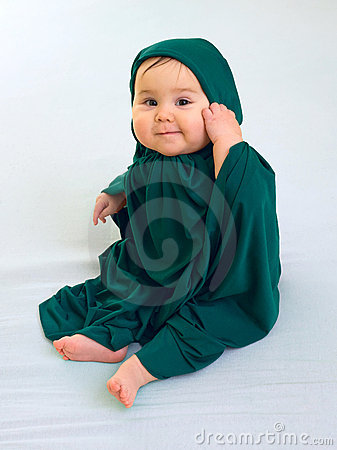 Happy baby girl in green muslim dress