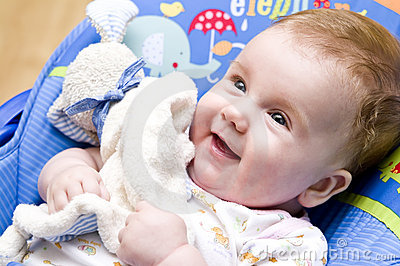 Happy baby girl with toy