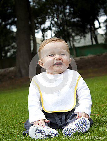 Happy baby on a grass