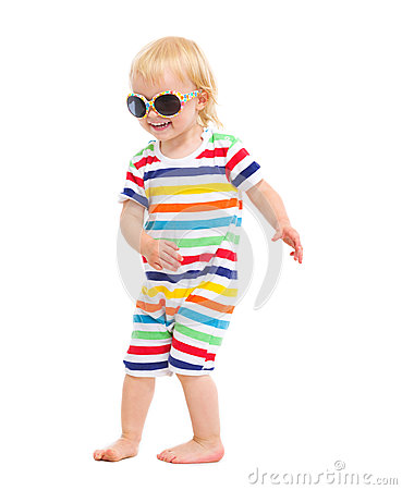Free Happy Baby In Swimsuit And Sunglasses Dancing Stock Photos - 25702593