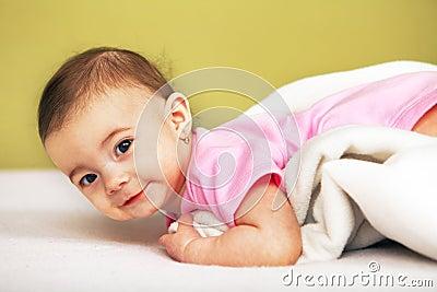Happy Baby lying on white towel