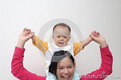 Happy baby on mother s shoulders