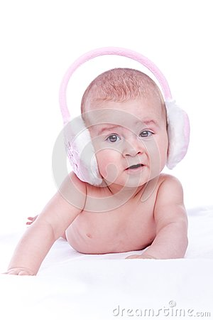 Happy baby with pink fur headphones