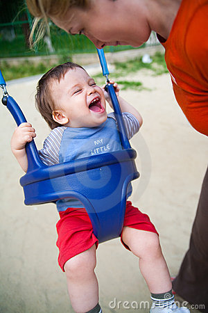 Happy baby in playground