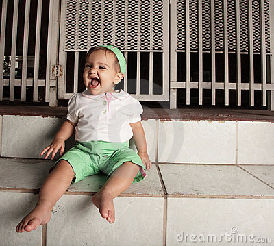 Happy baby on the steps