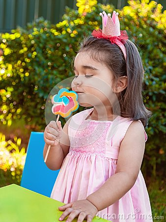 Free Happy Baby Toddler Girl Smelling And Savoring A Large Colorful Lollipop Smell, Scent Or Aroma Stock Photo - 104013340