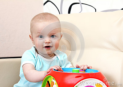 Happy baby with toy