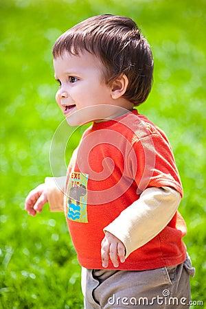 Happy baby walking outdoors