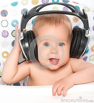 Free Happy Baby With Headphones Listening To Music Stock Photos - 31642503