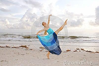 Happy ballerina on beach