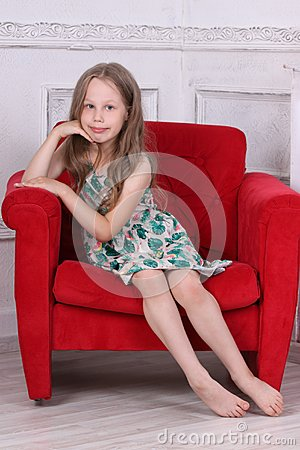Free Happy Barefoot Little Girl In Dress Sits Stock Photography - 99740492