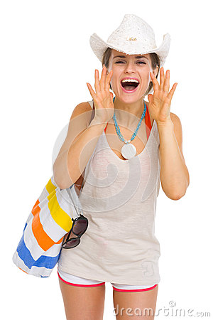 Happy beach woman shouting through megaphone shaped hands