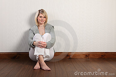 Happy beautiful blonde woman in knitted cardigan